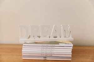 Dream sign on stack of magazines