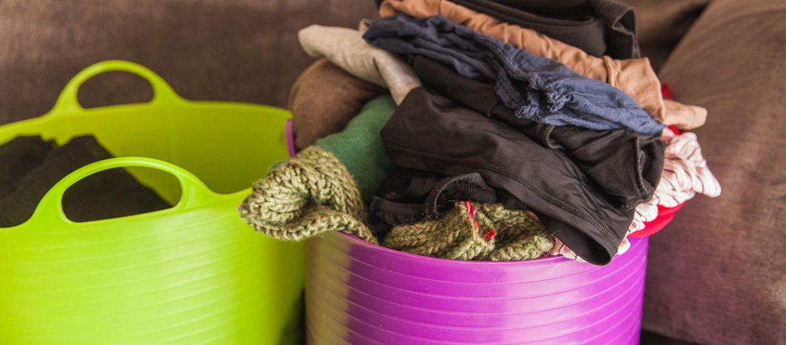 lots of washing, clothes to give away, washing basket, dirty laundry